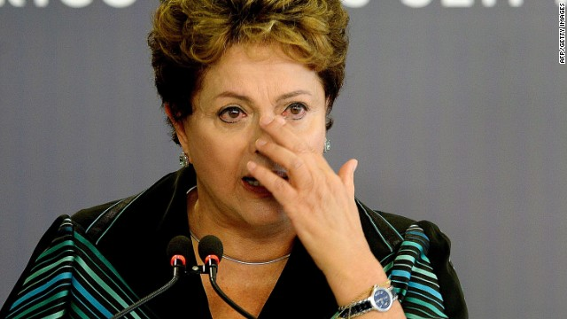 Brazilian President Dilma Rousseff cries while delivering a speech during the ceremony presenting the final report of the National Truth Commission (CNV) --which investigates those responsible for human rights violations between 1946 and 1988 in the country-- at the Planalto Palace in Brasilia, Brazil, on December 10, 2014. The report lists those responsible for political repression and admits --for the first time-- the disappearance of 434 people during the dictatorship. The disclosure of the document accompanies the International Human Rights Day commemoration. It also includes a list of places where forced interrogation, illegal arrests and enforced disappearances took place. AFP PHOTO/EVARISTO SAEVARISTO SA/AFP/Getty Images