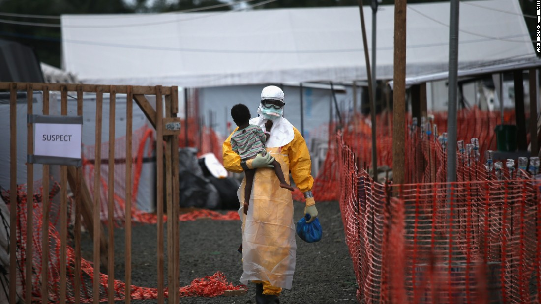 In order to stop Ebola in the future, scientists need to find out where exactly it is hiding and when it will be back. Pictured, a Doctors Without Borders health worker in Liberia carries a child suspected of having Ebola in October 2015.