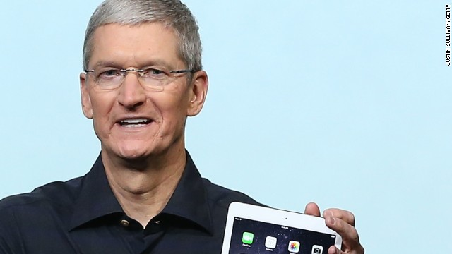 Apple CEO Tim Cook holds the new iPad Air 2 during a special event on October 16, 2014 in Cupertino, California. Apple unveiled the new iPad Air 2 tablet.