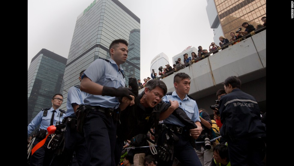 A protester is carried away by police officers on December 11.