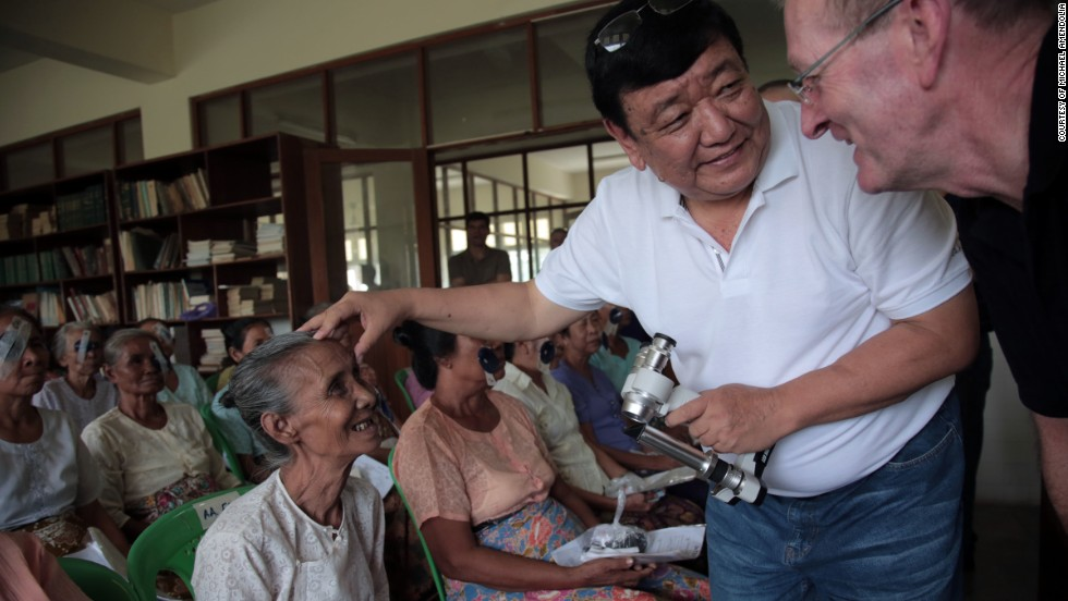 Dr. Sanduk Ruit examines Daw Yin, 65, after surgery in the Myanmar Outreach Eye Clinic in Yangon in 2013.