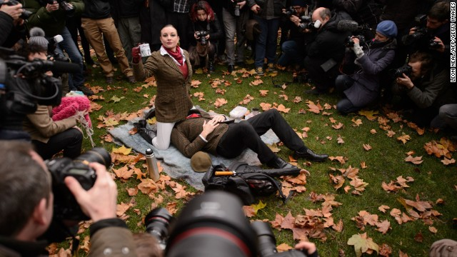 "Demonstrators take part in a mass ""face-sitting protest"" outside the Houses of Parliament in central London."