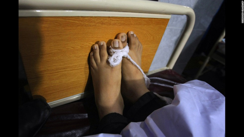 The body of a victim lies at a hospital in Peshawar.