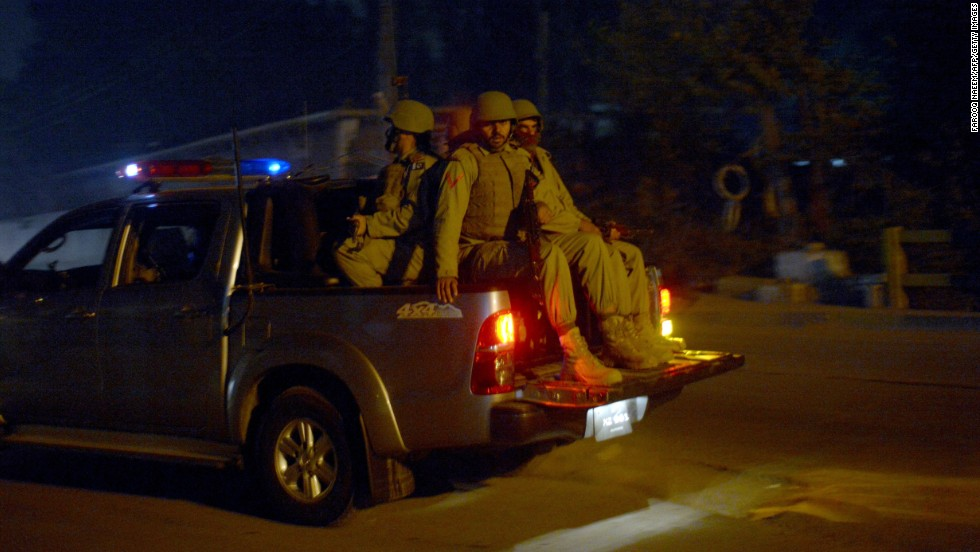 Soldiers patrol the streets in Peshawar, Pakistan, near a school that was attacked by the Pakistani Taliban on Tuesday, December 16. Militants stormed the military-run school in northwest Pakistan, killing more than 140 people, most of them children. More than 100 people were injured.