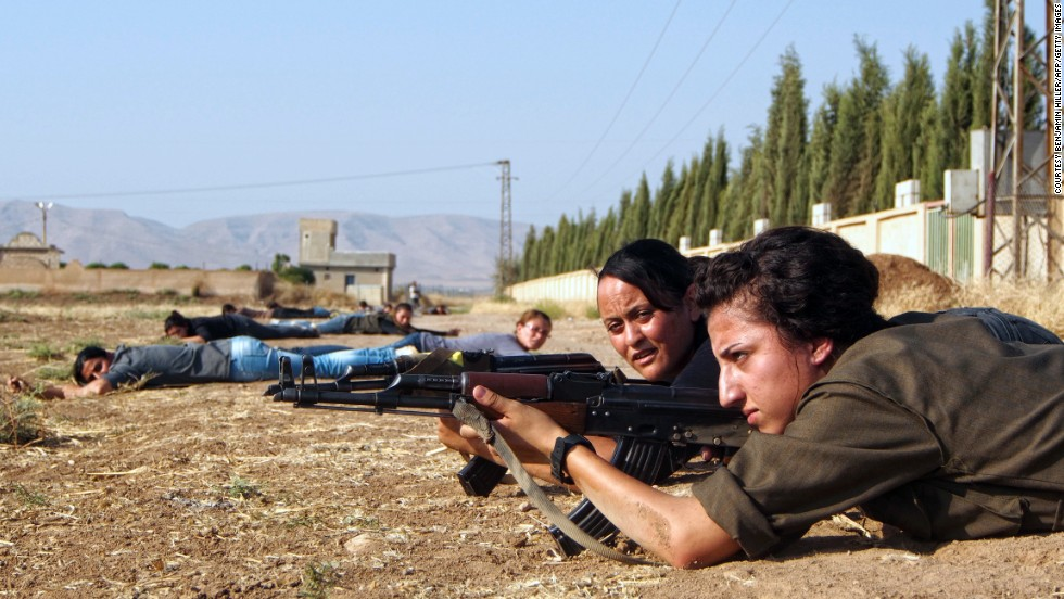 <strong>Kurdish female fighters </strong>-- The young fighters depicted are in training with the Kurdish Women's Defense Units (YPJ). The female fighters have trained for many years but this year have become notable for their courageous role in the war against the Islamic State of Iraq and Syria (ISIS).