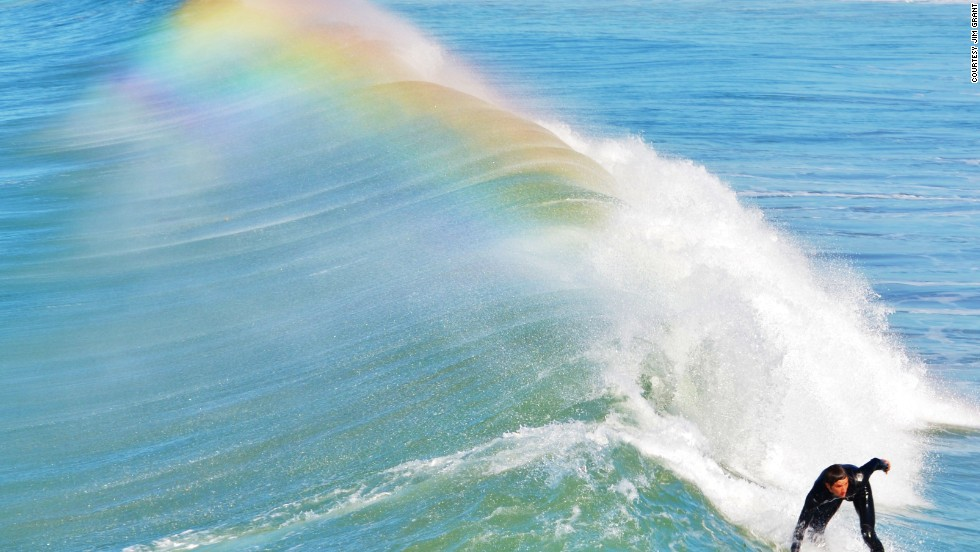 "A surfer rides a wave off the coast of <a href=""http://ireport.cnn.com/docs/DOC-1078219"">San Diego, California</a>."