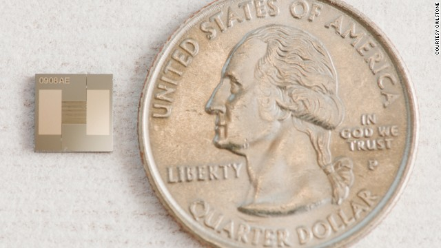 The tiny chip next to a U.S. quarter.