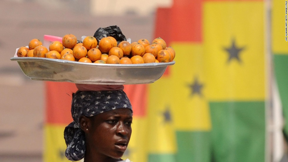 A street vendor in the Ghanaian capital of Accra sells her fruit. Over 53% of Ghana's total workforce was employed in agriculture in 2013, according to the FAO.