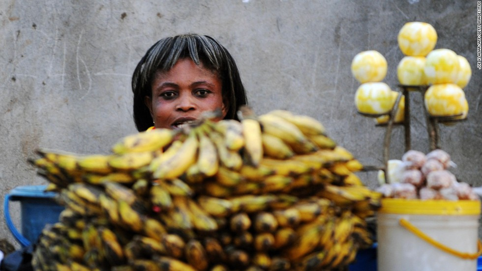 A fruit seller in Ghana sells bananas. West African countries produce nearly all Africa's banana exports and the region accounts for around 4% of the world banana trade.