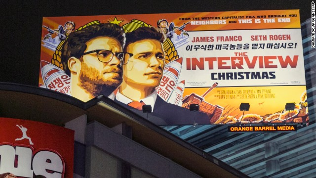 "A banner for ""The Interview""is posted outside Arclight Cinemas, Wednesday, Dec. 17, 2014, in the Hollywood section of Los Angeles. A U.S. official says North Korea perpetrated the unprecedented act of cyberwarfare against Sony Pictures that exposed tens of thousands of sensitive documents and escalated to threats of terrorist attacks that ultimately drove the studio to cancel all release plans for the film at the heart of the attack, ""The Interview."" (AP Photo/Damian Dovarganes)"