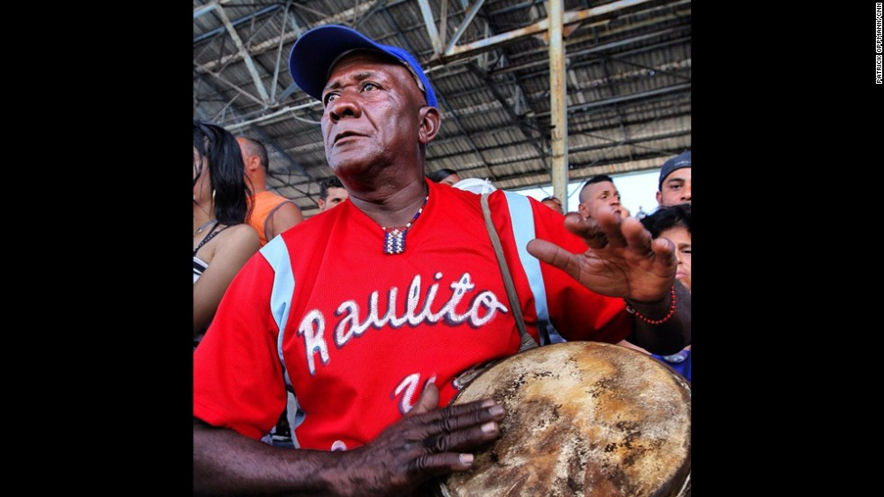 "A conga player bangs his drum during a Santiago-Havana baseball game. Oppmann says that the drums have fired up ballplayers for generations, but last year the Cuban government tried to ban the congas from baseball. ""After an avalanche of criticism, officials relented and the drums will play on,"" he says."