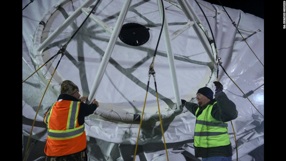 Crew work with the structure of the aerostat at Aberdeen Proving Ground, Maryland.