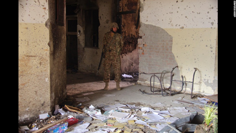 "A soldier walks outside the Pakistani school <a href=""http://www.cnn.com/2014/12/16/asia/gallery/taliban-attack-peshawar-school/index.html"">that was attacked</a> by members of the Pakistani Taliban on Tuesday, December 16. CNN cameraman Javed Iqbal took these photos in the aftermath of the attack, which killed more than 140 people."