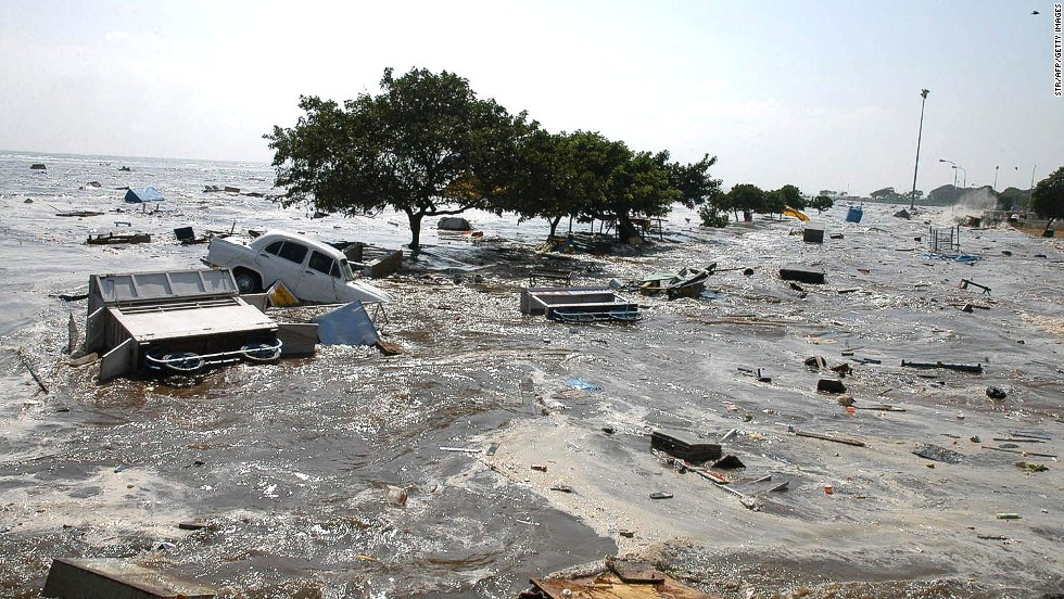 A general view of the scene at the Marina beach in Madras, 26 December 2004, after tidal waves hit the region. Tidal waves devastated the southern Indian coastline killing 1000 people, the home minister said, warning that the grim death toll was expected to rise. (Photo credit STR/AFP/Getty Images).