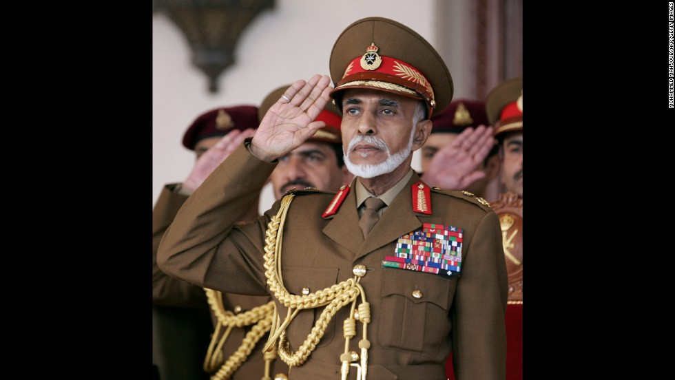 Sultan Qaboos bin Said of Oman salutes during a military parade in 2013.