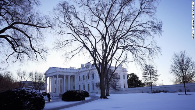 The White House is seen behind a lawn blanketed with snow on January 22, 2014 in Washington, DC.  The northeastern US shivered amid heavy snowfall and far below average temperatures Wednesday in a storm that grounded thousands of flights and triggered traffic chaos. AFP PHOTO/Mandel NGAN        (Photo credit should read MANDEL NGAN/AFP/Getty Images)