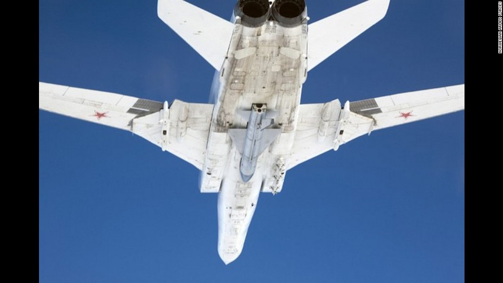 A look at a Russian Tu-22M from below as taken by a Norwegian Royal Air Force fighter plane.