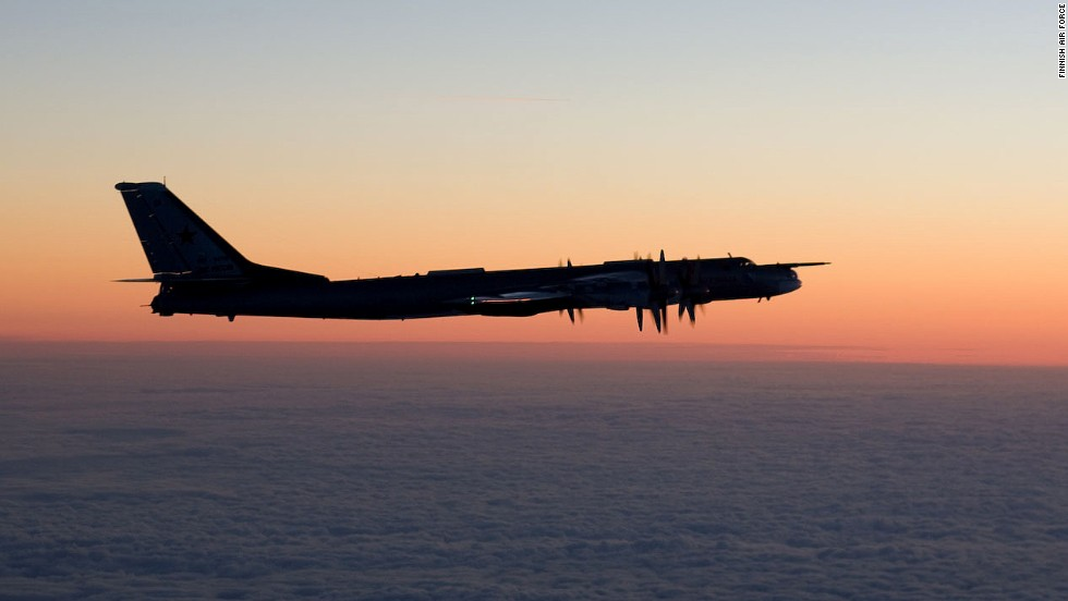 A Russian Tupolev Tu-95 Bear bomber intercepted by Finnish fighter planes.