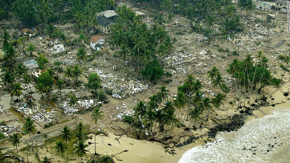 An aerial shot taken from a helicopter shows debris of houses destroyed by the tsunami waves in Galle, Sri Lanka, on December 27, 2004.