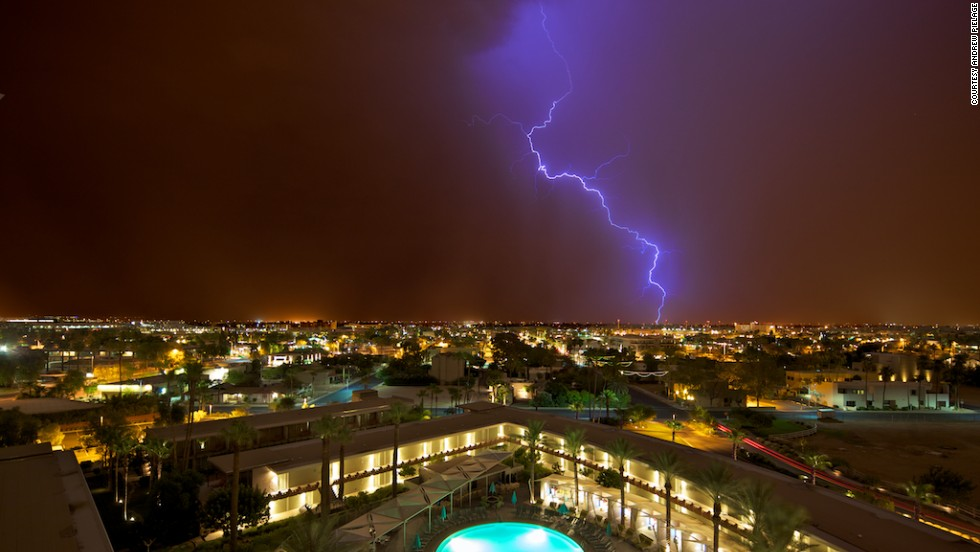 "Monsoon season in the American Southwest comes with extreme heat, crackling thunder and booming lightning. Photographer <a href=""http://ireport.cnn.com/docs/DOC-814216"">Andrew Pielage</a> captured this shot at exactly midnight in Scottsdale, Arizona, on July 12, 2012."