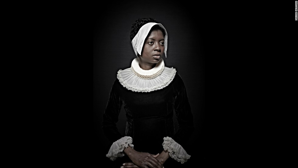 "A woman poses in 17th-century clothing as part of Maxine Helfman's photo series ""Historical Correction."" Helfman shot the series in 2012, posing black subjects to look like old Flemish paintings."