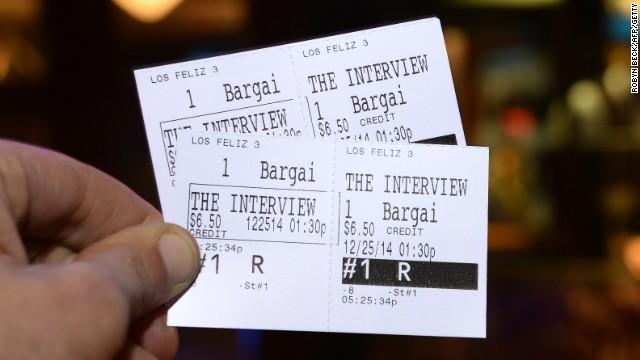 In this photo illustration two tickets for the movie 'The Interview' are seen in front of the Los Feliz 3 Cinema in Los Angeles, California on December 23, 2014, where 'The Interview' is scheduled to be shown December 25, 2014. Some US independent cinemas said they will show the Sony Pictures film on Christmas Day, a dramatic U-turn after its decision to cancel the film following a cyber-assault blamed on North Korea. AFP PHOTO / ROBYN BECK (Photo credit should read ROBYN BECK/AFP/Getty Images)