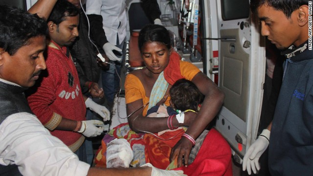 An injured women and her child arrive at a hospital in Assam, India on 23 December after a series of attacks by armed militants in the area.