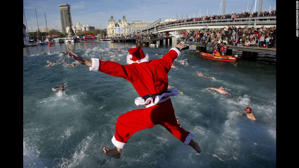 A Santa Claus jumps into the water during the 105th edition of the Christmas Cup in Barcelona's Port Vell on Thursday, December 25. Check out other images of the jolly old man across the globe during the holidays: