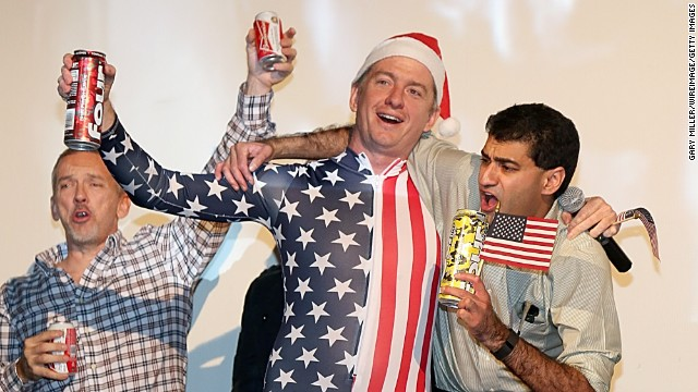 Caption:AUSTIN, TX - DECEMBER 25: Alamo Drafthouse Co-Founder and CEO Tim League, wearing a US Flag jumper and Santa hat, leads movie goers on a sing along of 'Proud To Be An American' before a screening of Sony Pictures' 'The Interview' which opens on Christmas Day, December 25, 2014 in Austin, Texas. Sony hackers have been releasing stolen information and threatened attacks on theaters which screened the film. (Photo by Gary Miller/WireImage/Getty Images)