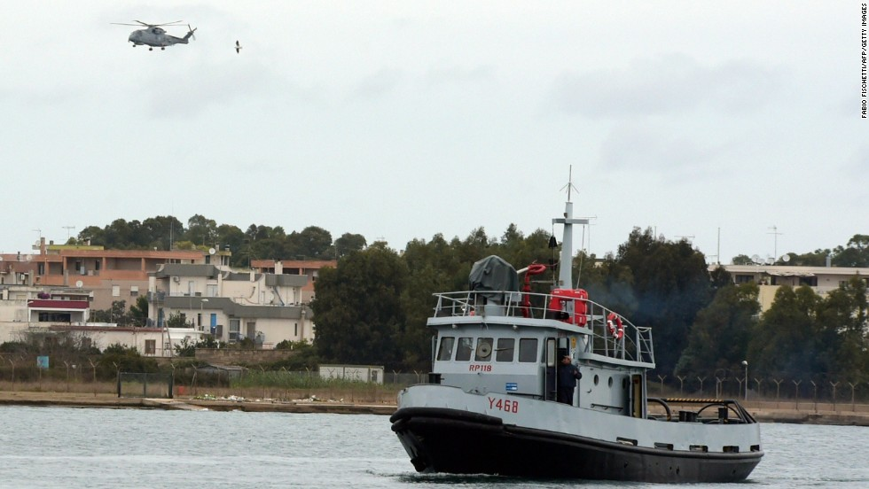 An Italian Navy helicopter and a rescue unit leave the port of Brindisi to take part in the rescue operations.