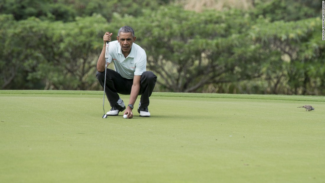 President Barack Obama prepares to putt as he plays golf with Malaysian Prime Minister Najib Razak at the Marine Corps Base in Hawaii in December 2014.