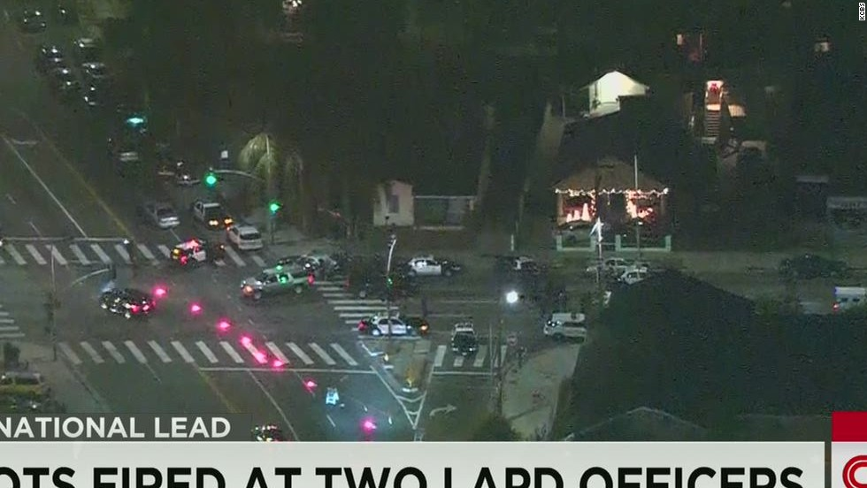 Officers shot at in Florida and Los Angeles