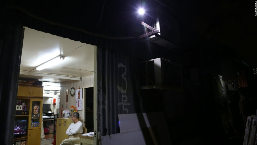 Residents keep their doors open in the evening to let light spill out onto the corridors.