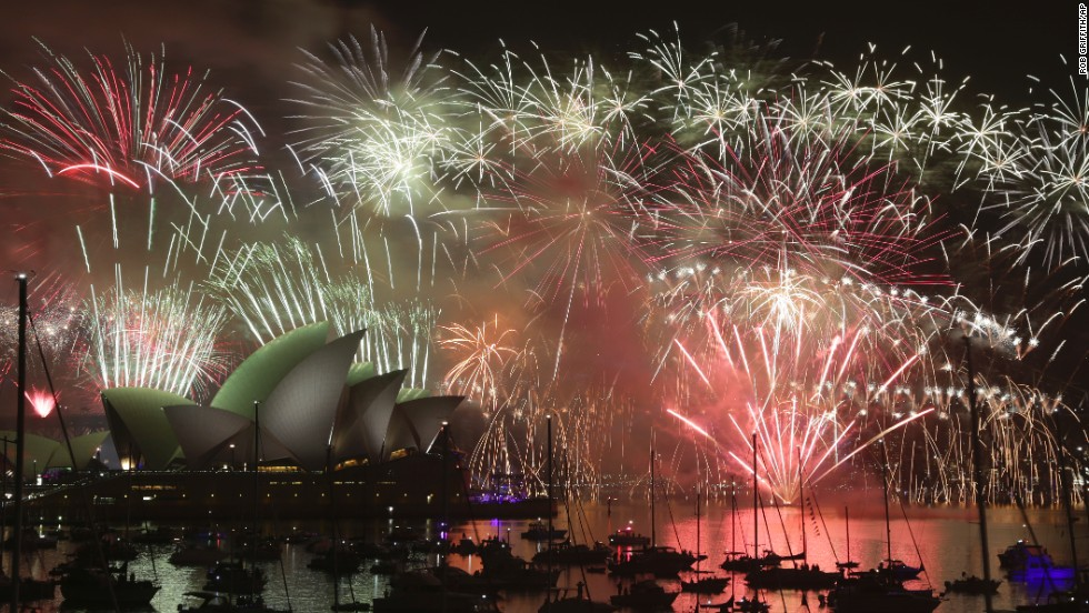 Fireworks light up the sky over the Sydney Opera House and the Sydney Harbour Bridge.