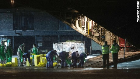 Pauline Cafferkey is wheeled in a quarantine tent trolley onto a Hercules Transport plane at Glasgow Airport on December 30, 2014.