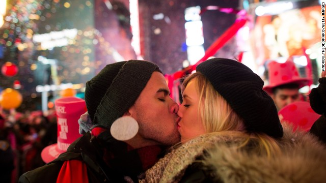 Angel Garcia and Rhea Coulson, of Florida, kiss at midnight as they celebrate the new year in Times Square in New York City.