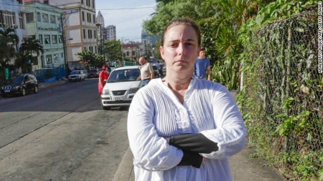 Cuban performance artist Tania Bruguera poses for a picture in a street of Havana, on December 31, 2014, upon her released from a police station. Bruguera was briefly released Wednesday but was re-arrested when she tried to go to Havana's main seaside avenue, the Malecon, to hold a press conference with other activists. Authorities had arrested Bruguera and 50 other dissidents yesterday to stop them from attending an open mic session convened by her at Revolution Square, an iconic plaza in front of Cuba's government headquarters, for Cubans to speak out about their future. The Cuban crackdown on dissident activists caused a new rift Wednesday with the United States, the first diplomatic scuffle since this month's historic announcement of a renewal in ties. AFP PHOTO / Adalberto ROQUE (Photo credit should read ADALBERTO ROQUE/AFP/Getty Images)