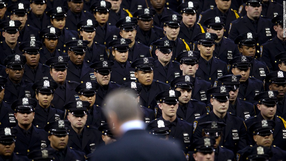 "New York Mayor Bill de Blasio speaks to the graduating class at the New York City Police Academy on Monday, December 29. He <a href=""http://www.cnn.com/video/data/2.0/video/us/2014/12/30/mxp-de-blasio-booed-at-police-graduation.hln.html"" target=""_blank"">received some boos at the event</a> as some believe his comments after the death of Eric Garner have contributed to <a href=""http://www.cnn.com/2014/12/22/politics/de-blasio-police-shooting/index.html"" target=""_blank"">an anti-police sentiment.</a>"