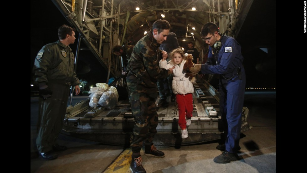 "Serafina Gondolo, a rescued passenger of <a href=""http://www.cnn.com/2014/12/28/world/gallery/greece-italy-ferry-fire/index.html"">the Norman Atlantic ferry accident,</a> is helped off an airplane as she arrives at an air base in Greece on Monday, December 29. At least 10 people died after <a href=""http://www.cnn.com/2014/12/28/world/europe/ferry-fire-italy-greece/index.html"" target=""_blank"">the ferry caught fire in the Adriatic Sea,</a> but more than 400 were saved, according to the Italian coast guard."