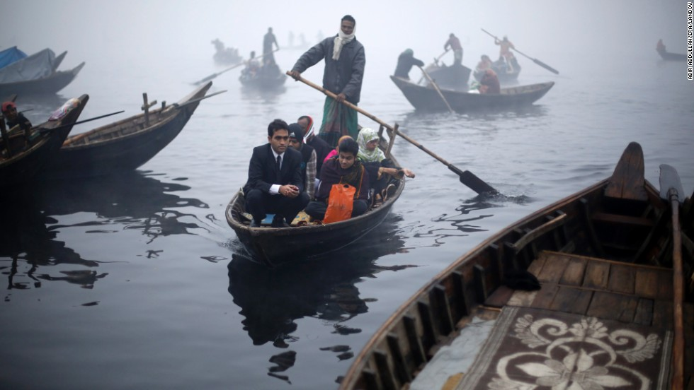 People are rowed across the Buriganga River in Dhaka, Bangladesh, on Monday, December 29.