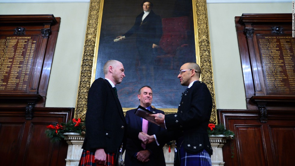 Joe Schofield, right, and Malcolm Brown are married in Glasgow, Scotland, on Wednesday, December 31. It was one of the first same-sex marriages in the country, which changed its law in March.
