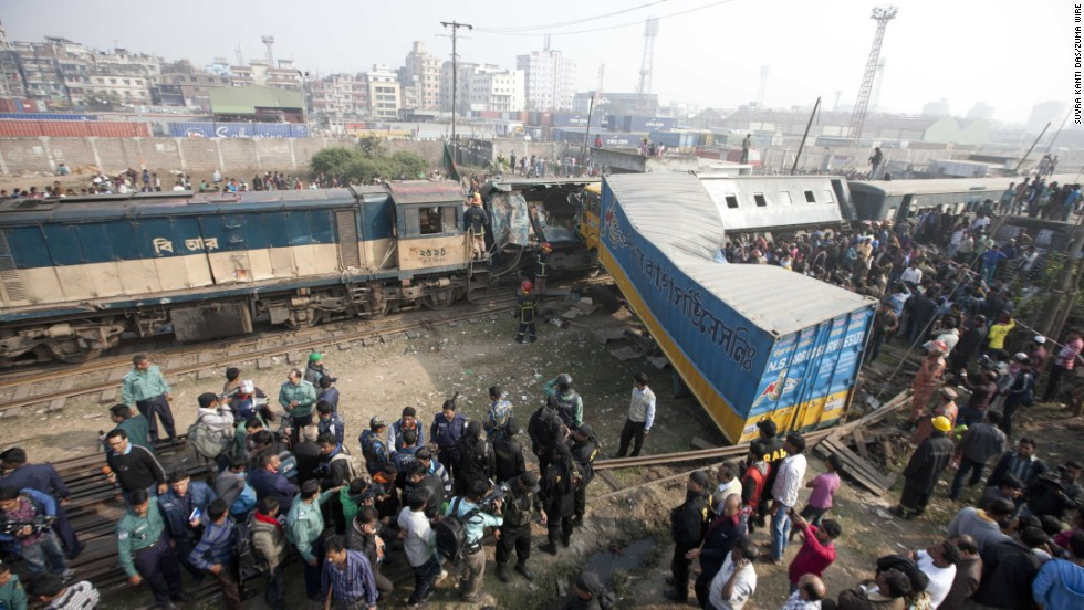 People gather in Dhaka, Bangledesh, after a truck rammed into a passenger train Monday, December 29. Several people were killed and more than 20 were injured.