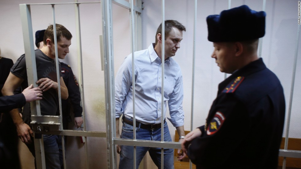 "Blogger and Kremlin critic Alexey Navalny, second from right, enters a cage at a court in Moscow on Tuesday, December 30. He and his brother Oleg, left, <a href=""http://www.cnn.com/2014/12/30/world/europe/russia-alexei-navalny-case/index.html"" target=""_blank"">were convicted of fraud</a> and given a suspended sentence of three and a half years. The brothers denied charges of embezzling 30 million rubles ($540,000) from a Russian subsidiary of French cosmetics company Yves Rocher between 2008 and 2012."