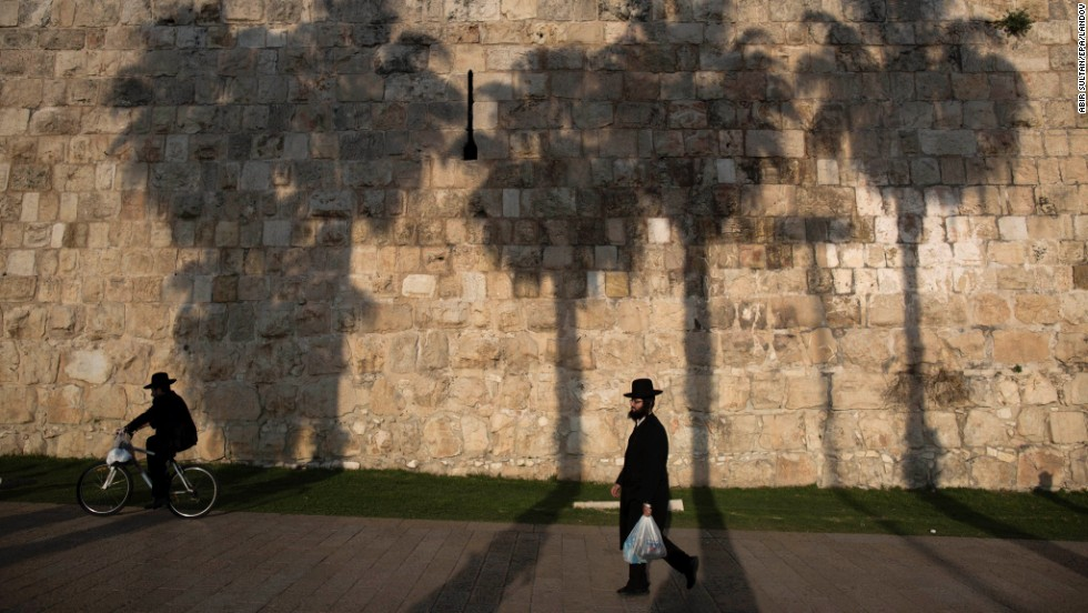 An ultra-Orthodox Jewish man walks near the wall of the Old City of<br />Jerusalem on Monday, December 29.