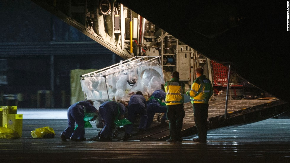 "Pauline Cafferkey, a Scottish woman diagnosed with Ebola, is put on a plane in Glasgow, Scotland, on Tuesday, December 30. Cafferkey, a 39-year-old nurse who volunteered in Sierra Leone, <a href=""http://www.cnn.com/2014/12/31/world/europe/uk-ebola/index.html"" target=""_blank"">was being transported to London</a> for treatment."