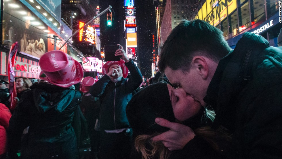 "Sean Reilly and Emily Verselin share a kiss at midnight during a <a href=""http://www.cnn.com/2014/12/31/world/gallery/2015-new-year/index.html"" target=""_blank"">New Year's celebration</a> in New York's Times Square. <a href=""http://www.cnn.com/2014/12/26/world/gallery/week-in-photos-1226/index.html"" target=""_blank"">See last week in 22 photos</a>"