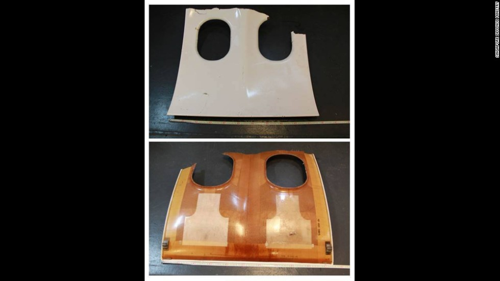 This photograph released by the Singapore Defense Ministry shows the front and back of a piece of debris that resembles an aircraft window panel.