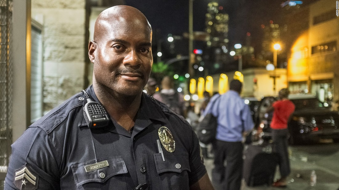 "LAPD Officer Deon Joseph has patrolled Skid Row for 17 years. This photo was taken by John Hwang as part of his <a href=""http://skidrowstories.com/"" target=""_blank"">Skid Row Stories</a> series. Hwang is an occupational therapist who has been photographing the men and women of Skid Row. Let him introduce you to some of them in the photos that follow."