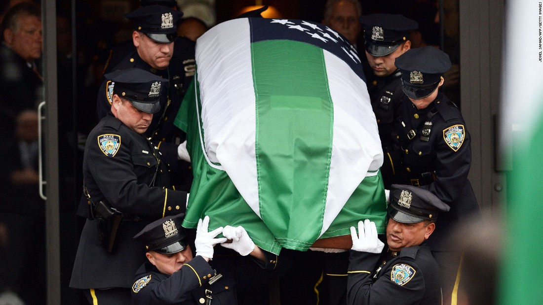 NYPD officers carry the casket of slain officer Wenjian Liu.