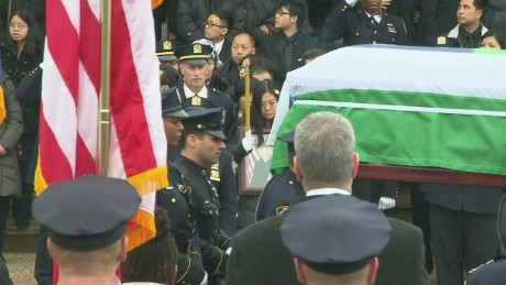 Police pay tribute to slain NYPD officer